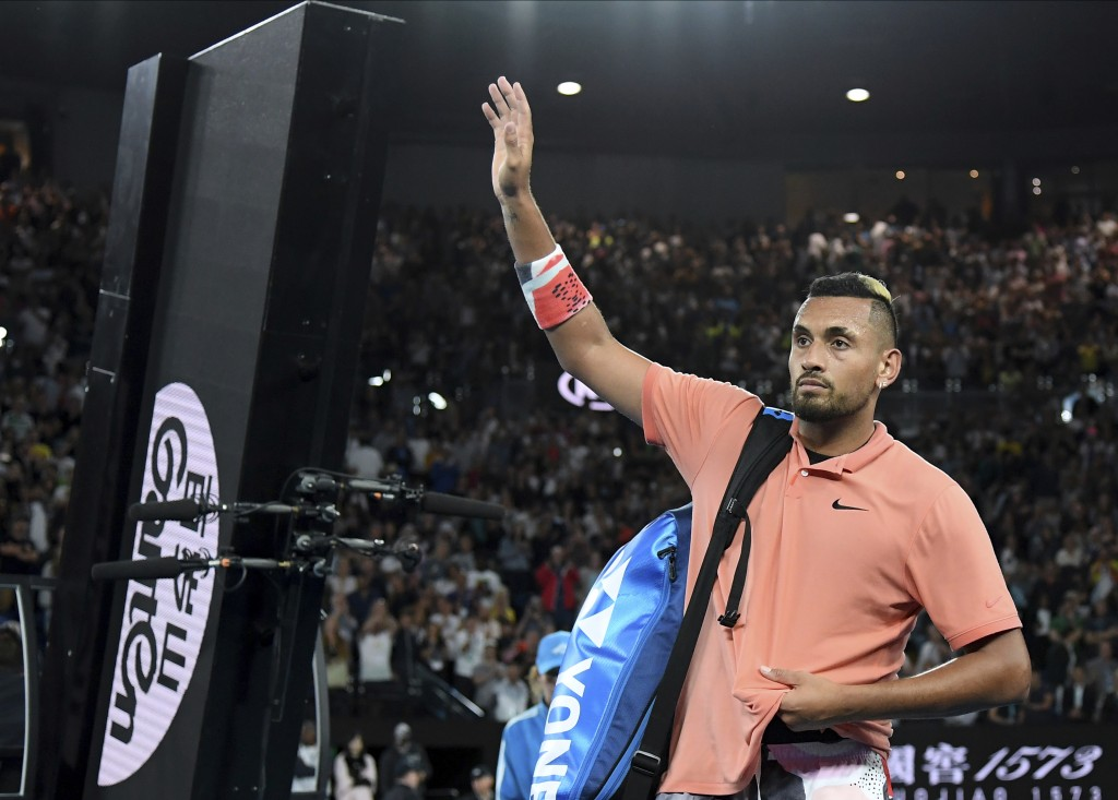 Australia's Nick Kyrgios waves after losing his their fourth round singles match to Spain's Rafael Nadal at the Australian Open tennis championship in...