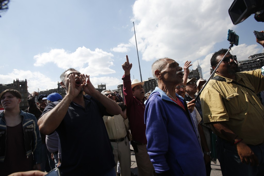 """People shout against members of the LeBaron family and activist and poet Javier Sicilia during a march against violence called """"Walk for Peace,"""" in Me..."""