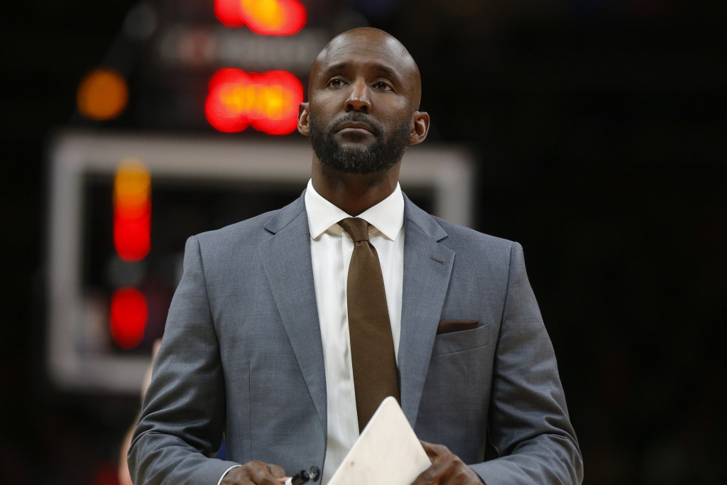 Atlanta Hawks head coach Lloyd Pierce looks on during a break in play during the first half of an NBA basketball game against the Washington Wizards, ...