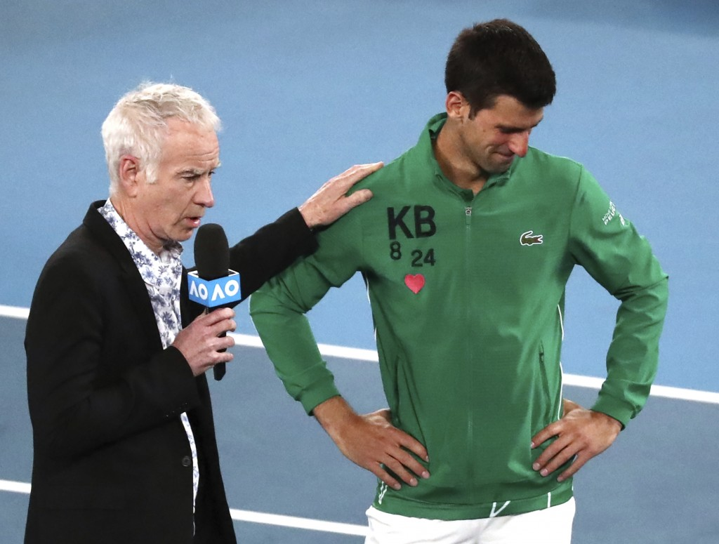 Serbia's Novak Djokovic reacts as he is interviewed by John McEnroe about the death of his friend Kobe Bryant following his quarterfinal win over Cana...
