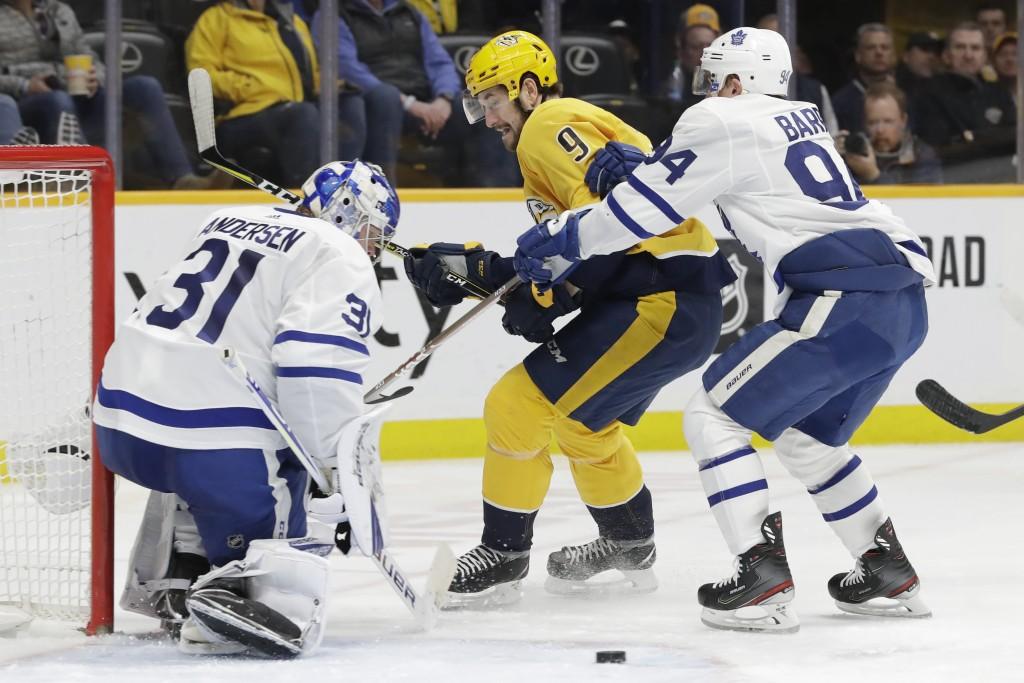 Toronto Maple Leafs goaltender Frederik Andersen (31), of Denmark, blocks a shot as defenseman Tyson Barrie (94) keeps Nashville Predators left wing F...