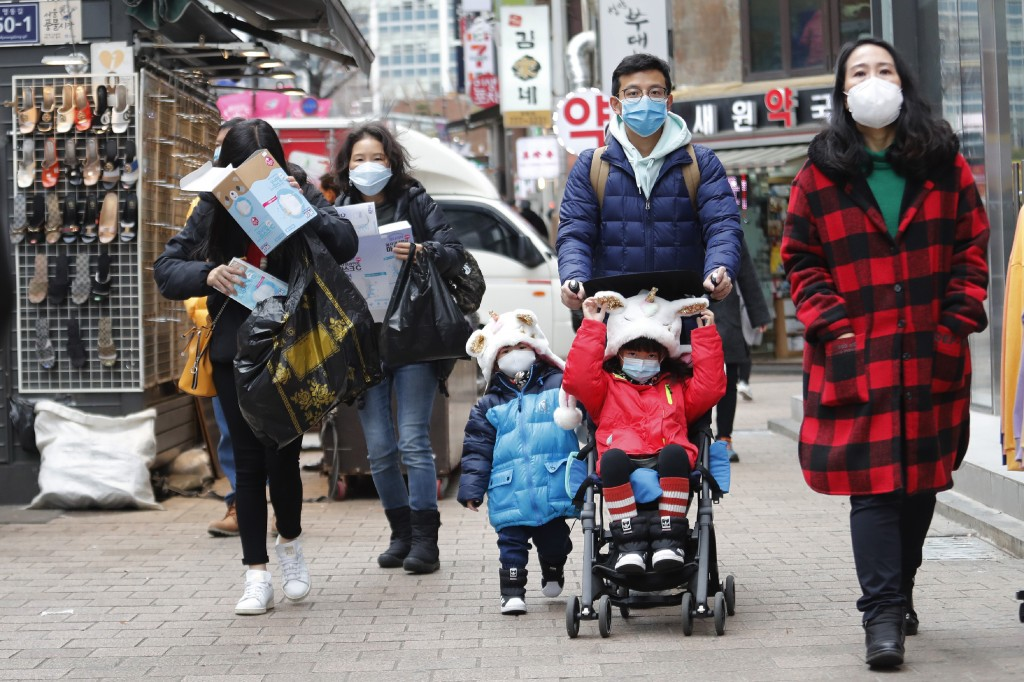 People wear masks at a shopping district in Seoul, South Korea, Tuesday, Jan. 28, 2020. Panic and pollution drive the market for protective face masks...