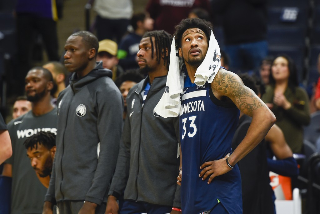 Minnesota Timberwolves forward Robert Covington, right, checks the scoreboard in the final seconds of overtime against the Sacramento Kings as Timberw...