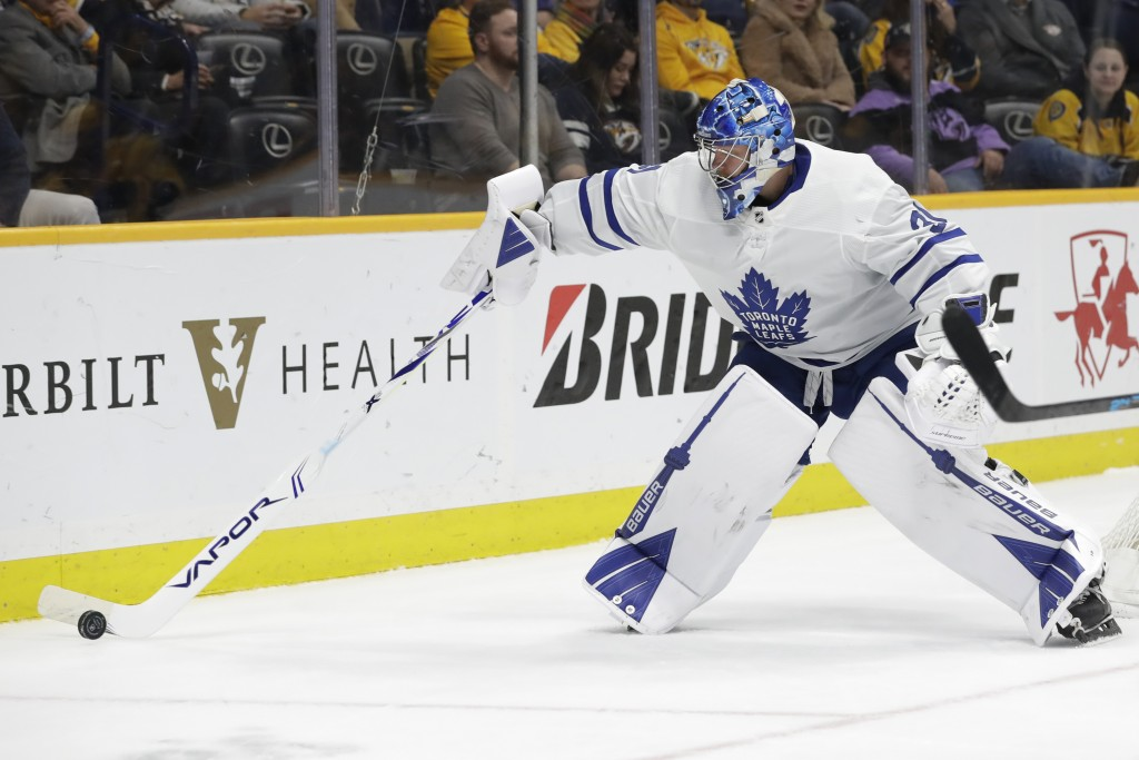 Toronto Maple Leafs goaltender Frederik Andersen, of Denmark, plays the puck in the second period of an NHL hockey game against the Nashville Predator...