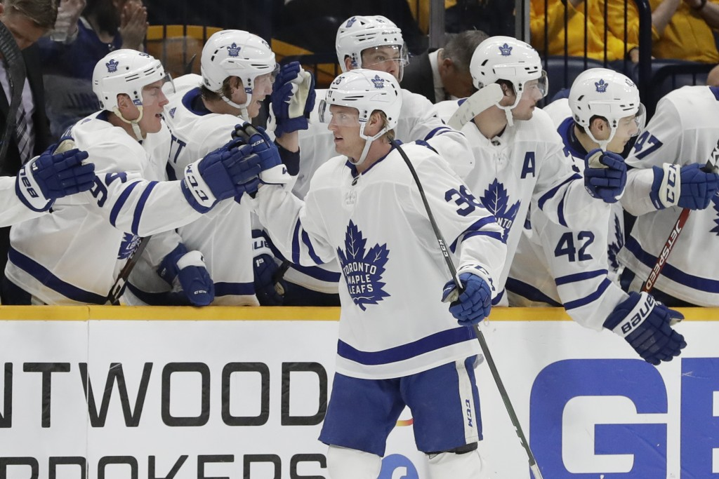 Toronto Maple Leafs defenseman Rasmus Sandin (38), of Sweden, is congratulated after scoring a goal against the Nashville Predators in the second peri...