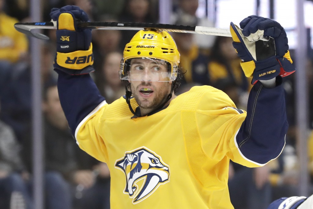 Nashville Predators right wing Craig Smith reacts to a missed scoring chance against the Toronto Maple Leafs in the second period of an NHL hockey gam...