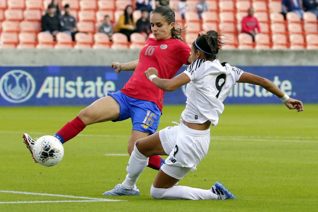 Costa Rica midfielder Katherine Alvarado (16) kicks away the ball as Panama forward Amarelis De Mera (9) slides in for an attempted steal during the f...