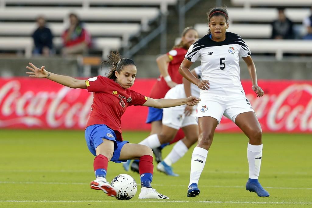 Costa Rica midfielder Katherine Alvarado, left, kicks away the ball in from of Panama defender Yerenis De Leon (5) during the first half of a women's ...