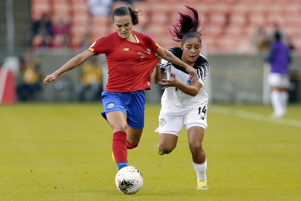 Panama defender Maryorie Perez (14) pulls on the jersey of Costa Rica forward Melissa Herrera (7) during the first half of a women's Olympic qualifyin...