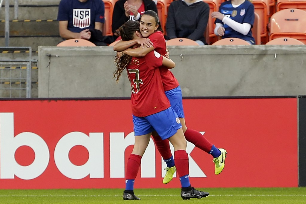 Costa Rica forward Maria Salas (17) lifts forward Melissa Herrera, right, after Herrera's score against Panama during the first half of a women's Olym...