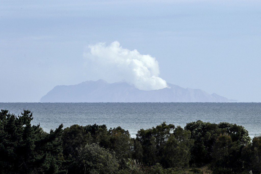 FILE - In this Dec. 11, 2019, file photo, plumes of steam rise above White Island off the coast of Whakatane, New Zealand. Another person who suffered...