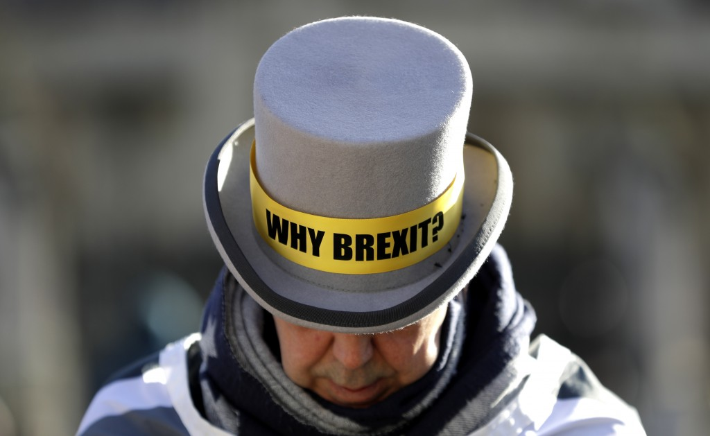 Why Brexit? written on the hat of Anti-Brexit campaigner Steve Bray as he stands outside Parliament in London, Wednesday, Jan. 29, 2020. Britain offic...