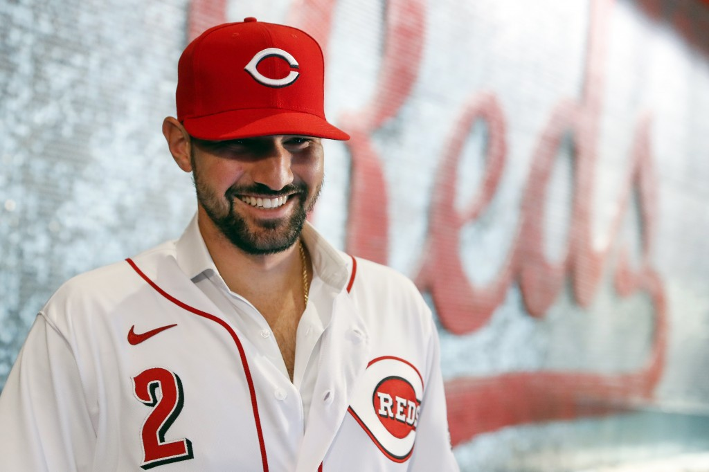 Cincinnati Reds' Nick Castellanos waits for interviews to begin during a news conference announcing his signing with the baseball club, Tuesday, Jan. ...