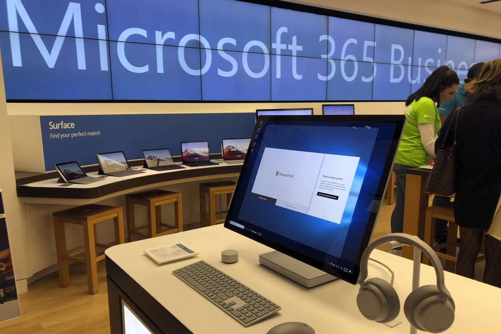 In this Tuesday, Jan. 28, 2020, photo a Microsoft computer is among items displayed at a Microsoft store in suburban Boston. Microsoft reports financi...