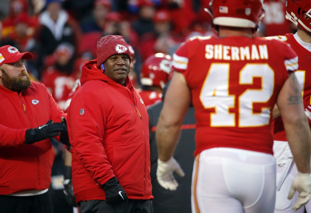 FILE - In this Jan. 20, 2019, file photo, Kansas City Chiefs offensive coordinator Eric Bieniemy watches players before the team's AFC championship NF...