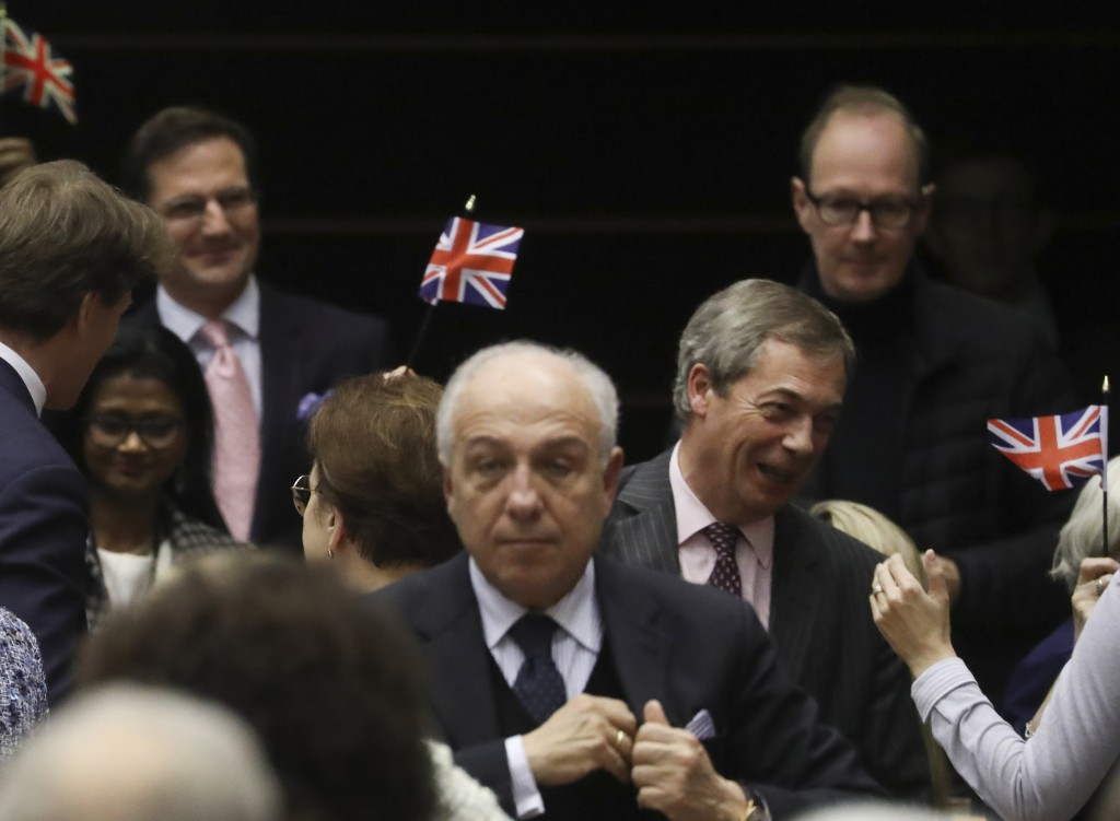 Brexit Party leader Nigel Farage, third right, reacts after the vote on the UK's withdrawal from the EU, the final legislative step in the Brexit proc...