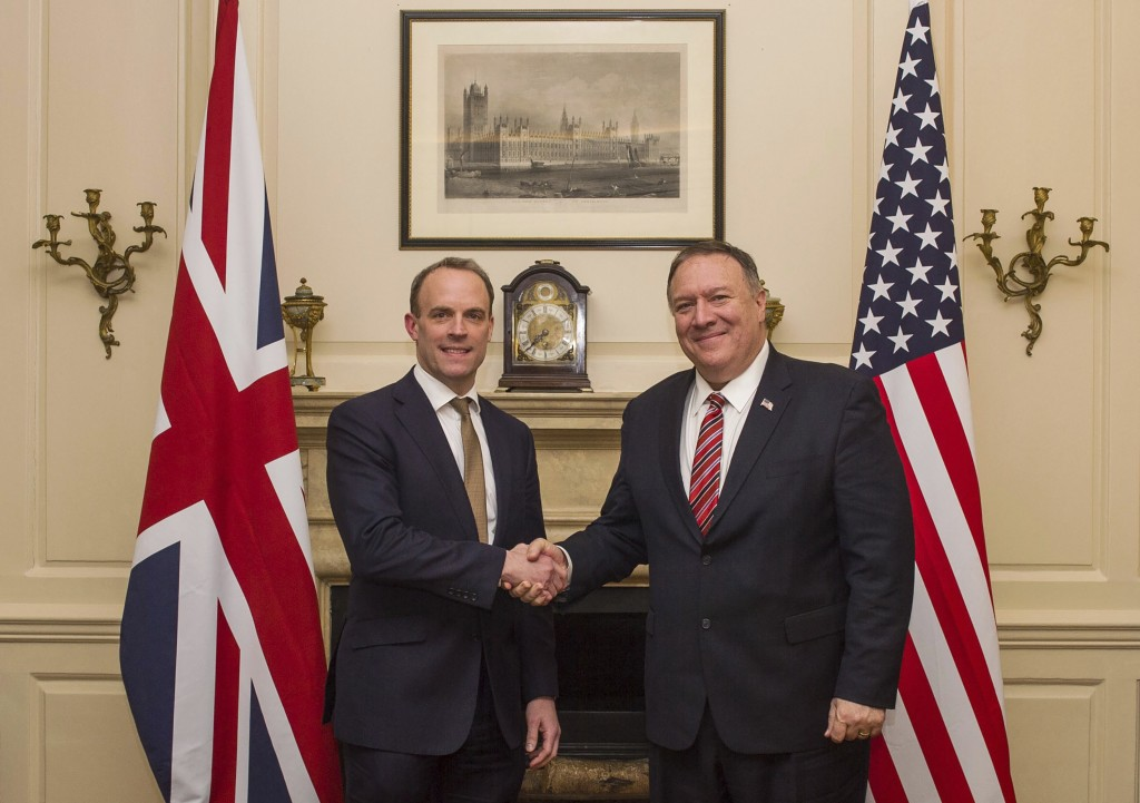 UK Foreign Secretary Dominic Raab shakes hands with US Secretary of State Mike Pompeo, right, in London, Wednesday Jan. 29, 2020.  Pompeo is in the UK...