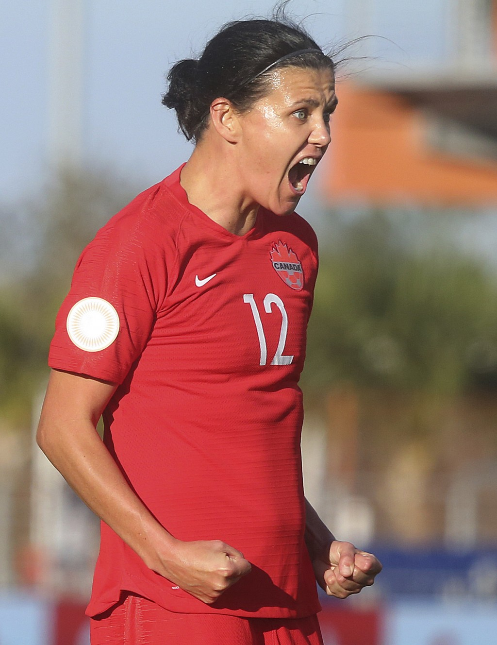 Canada's Christine Sinclair celebrates after scoring against St. Kitts and Nevis during a CONCACAF women's Olympic qualifying soccer match Wednesday, ...