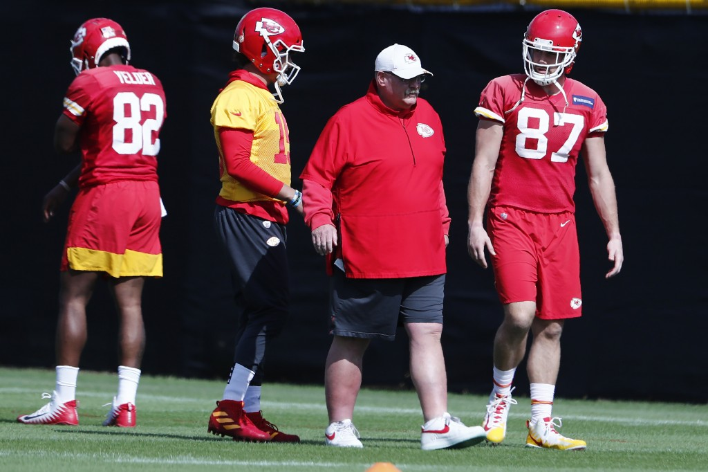 Kansas City Chiefs quarterback Patrick Mahomes (15) and tight end Travis Kelce (87) walk with head coach Andy Reid during practice on Thursday, Jan. 3...