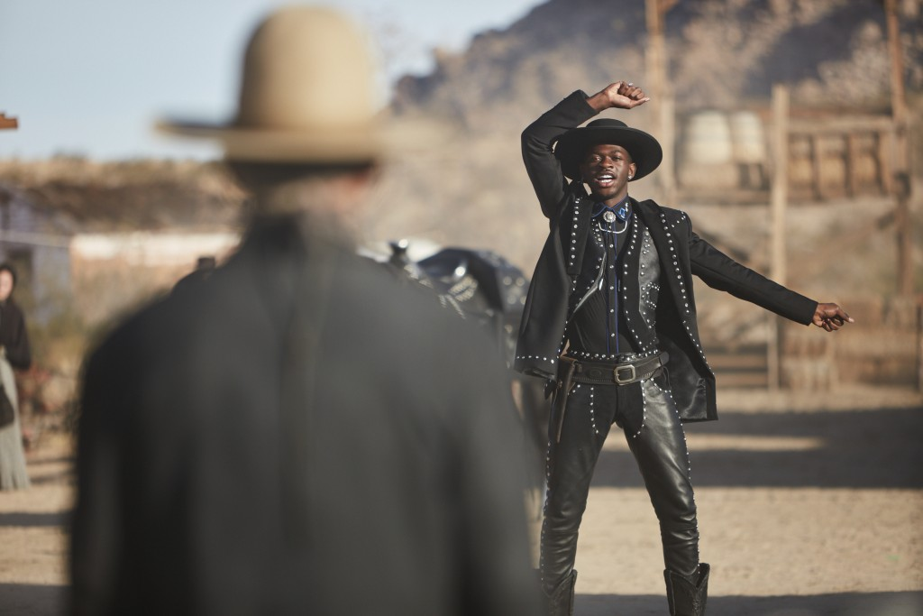This undated photo provided by Doritos shows Lil Nas X, right, and Sam Elliott in a scene from the company's 2020 Super Bowl NFL football spot. The sn...