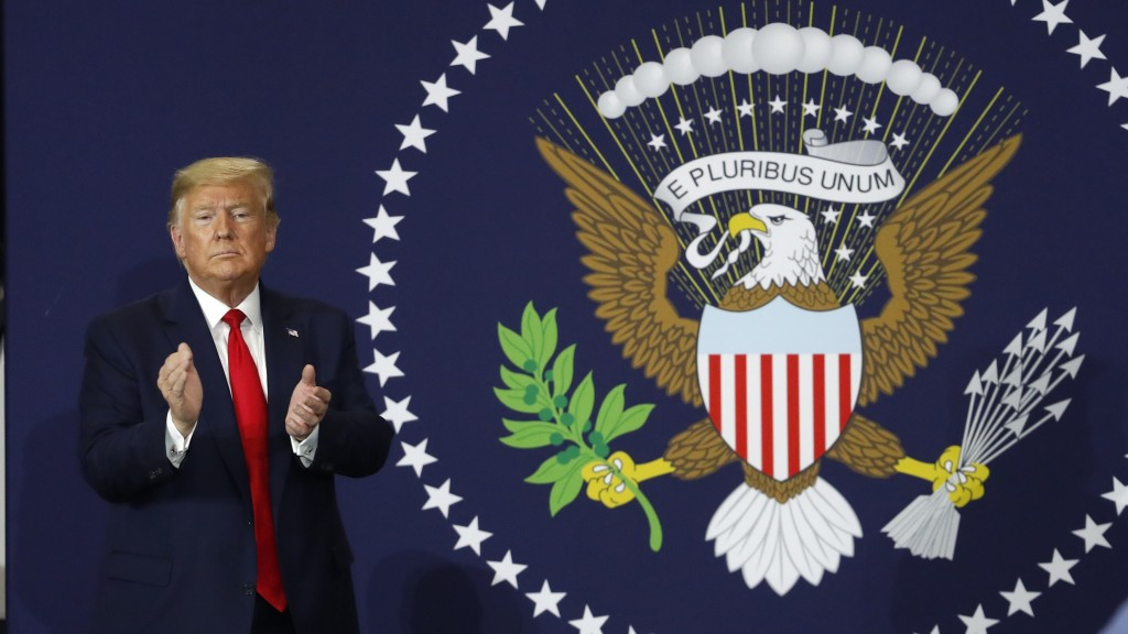 President Donald Trump claps after speaking at Dana Incorporated, Thursday, Jan. 30, 2020, in Warren, Mich., about the new North American trade agreem...