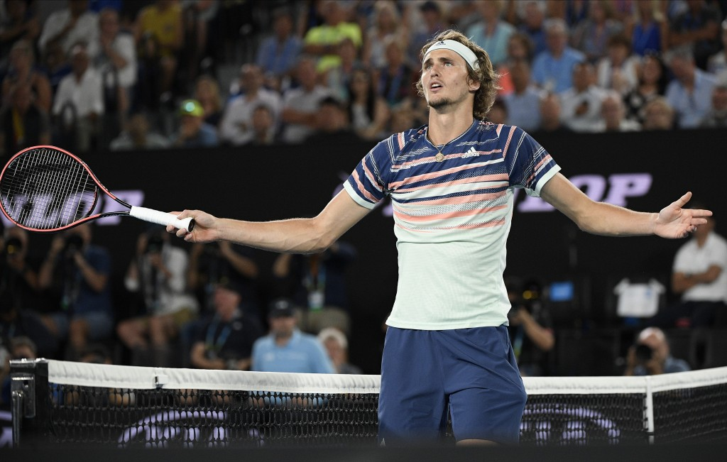 Germany's Alexander Zverev gestures as he argues with the chair umpire over a line call during his semifinal match against Austria's Dominic Thiem at ...