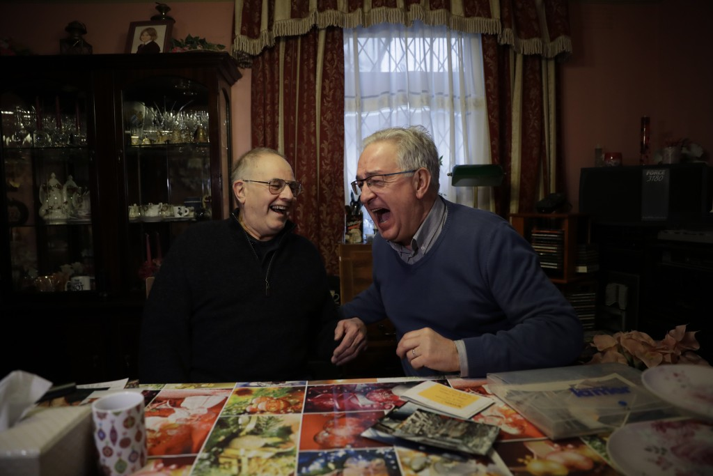 Former British Channel Tunnel worker Graham Fagg, left, and Former French Channel Tunnel worker Philippe Cozette laugh together during an interview wi...