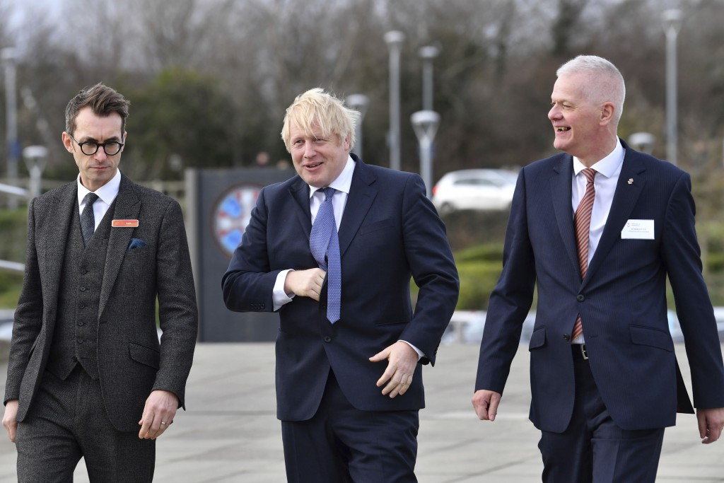 Britain's Prime Minister Boris Johnson, center, arrives for a cabinet meeting at National Glass Centre at the University of Sunderland, the city which...