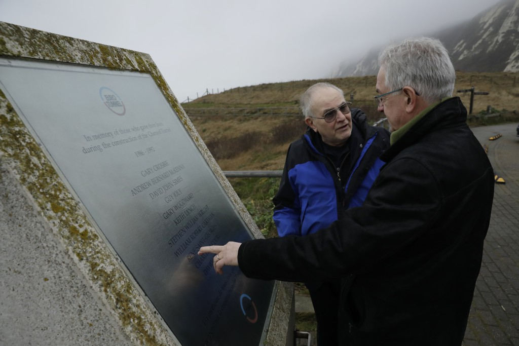 Former British Channel Tunnel worker Graham Fagg, left, and Former French Channel Tunnel worker Philippe Cozette look at a memorial plaque in memory o...
