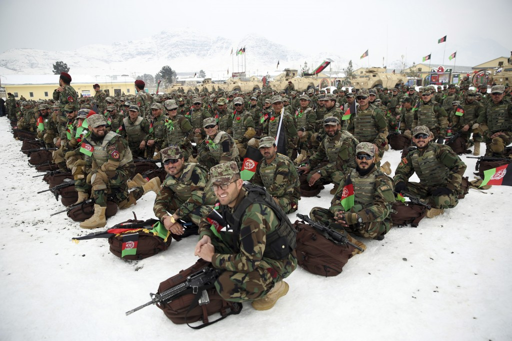 FILE- in this Monday, Jan. 13, 2020, file photo, Afghan Army commandos attend their graduation ceremony after a 3 1/2 month training program at the Co...