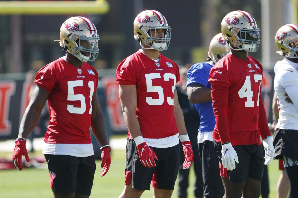 San Francisco 49ers linebackers Azeez Al-Shaair (51) Mark Nzeocha (53), of Germany, and Elijah Lee (47) line up during practice, Thursday, Jan. 30, 20...