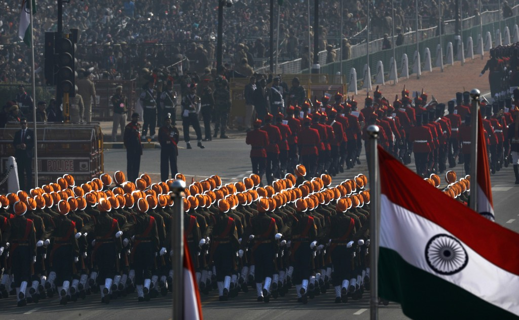 In this Sunday, Jan. 26, 2020, file photo, India's Republic Day parade marches through Rajpath, the ceremonial boulevard in New Delhi, India. Sunday's...