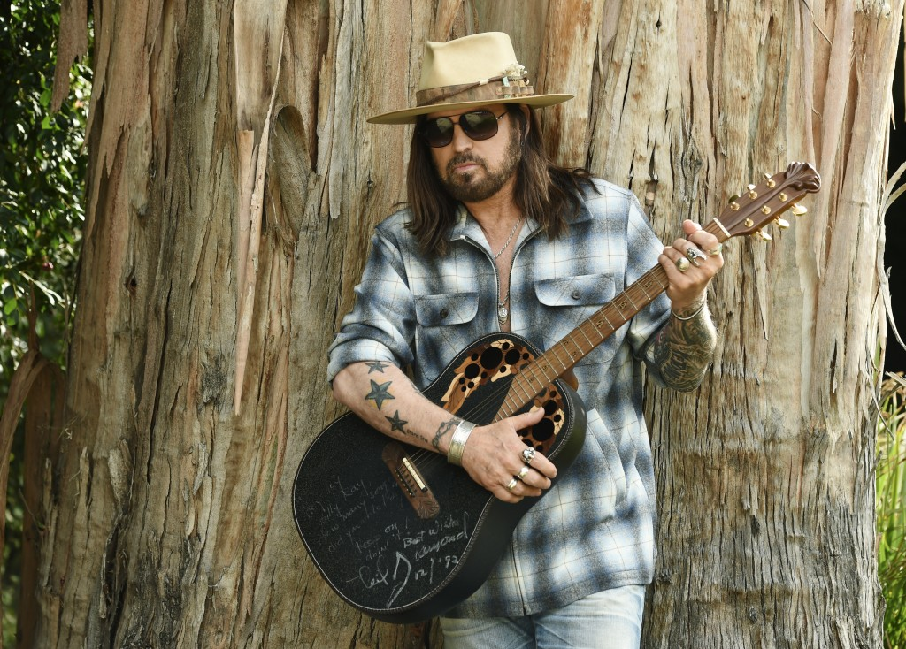"CORRECTS NAME OF THREE-SONG EP TO ""THE SINGIN' HILLS SESSIONS VOL. 1 SUNSET"" - Singer-songwriter Billy Ray Cyrus poses for a portrait with an Ovation ..."