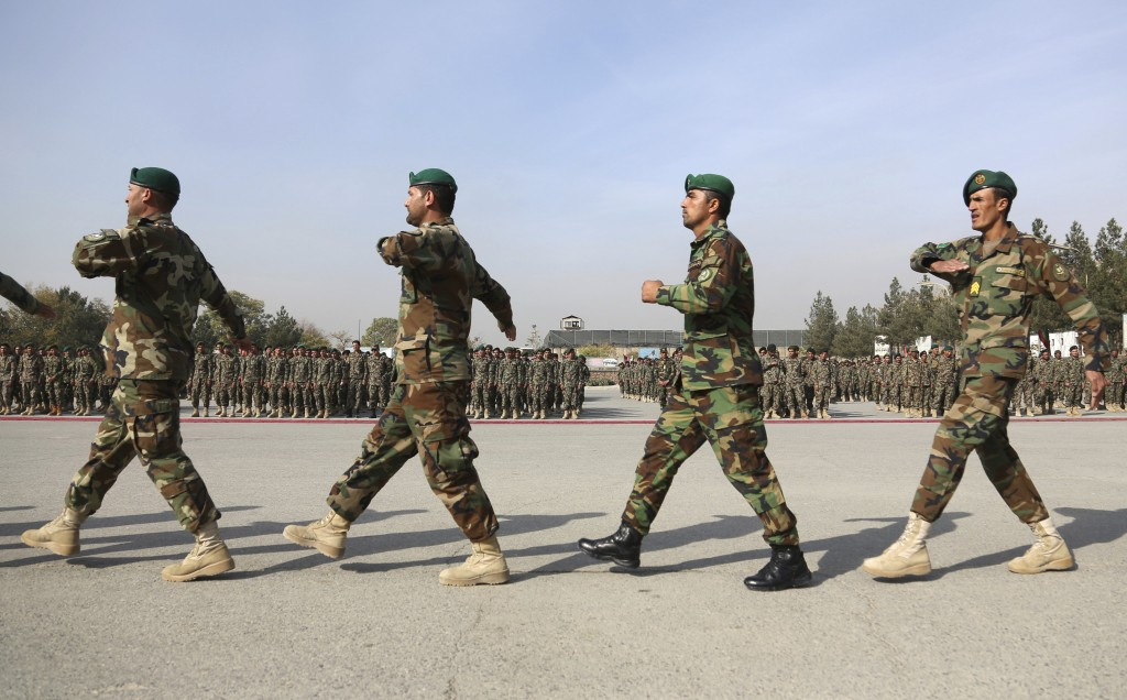 FILE- in this Monday, Oct. 28, 2019, file  photo, newly graduated Afghan National Army march during their graduation ceremony after a three month trai...