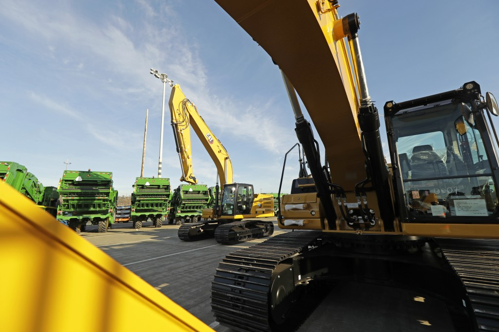 FILE - In this Nov. 4, 2019, file photo construction equipment made by Caterpillar are readied for export to Asia at the Port of Tacoma in Tacoma, Was...