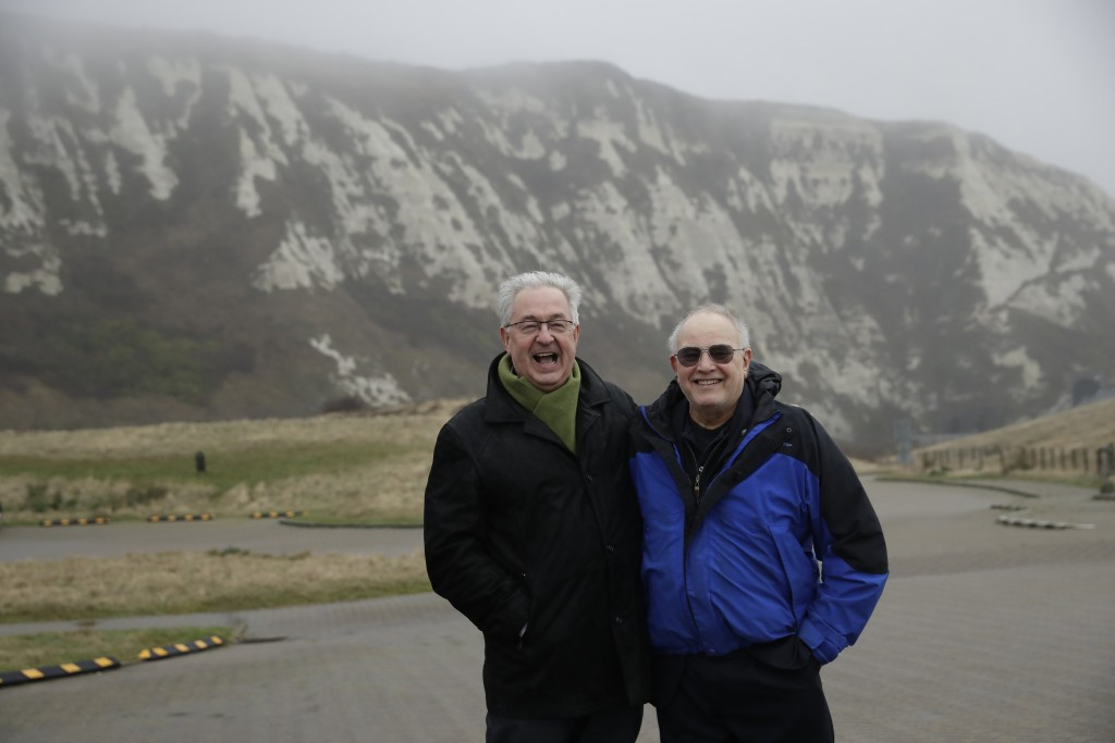 Former British Channel Tunnel worker Graham Fagg, right, and Former French Channel Tunnel worker Philippe Cozette pose for photographs together at Sam...
