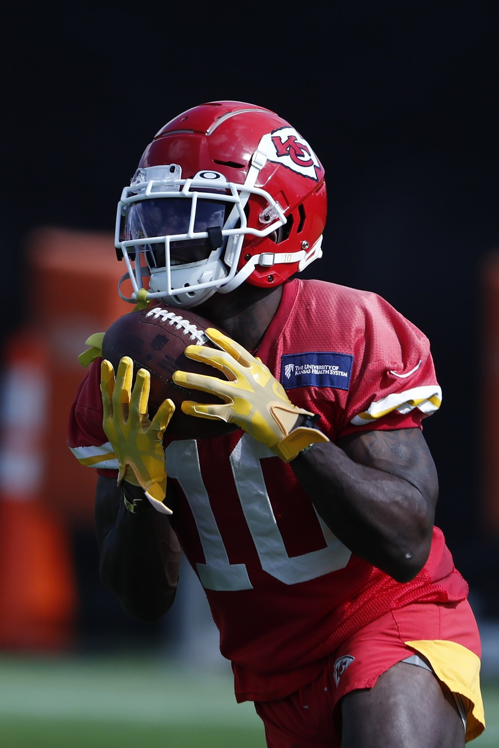 Kansas City Chiefs wide receiver Tyreek Hill (10) catches the ball during practice on Thursday, Jan. 30, 2020, in Davie, Fla., for the NFL Super Bowl ...
