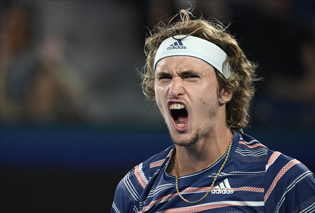 Germany's Alexander Zverev reacts after winning a game against Austria's Dominic Thiem during their semifinal match at the Australian Open tennis cham...