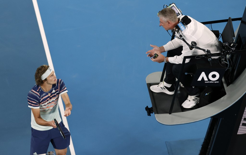 Germany's Alexander Zverev, left, gestures as he argues with chair umpire John Blom during his semifinal match against Dominic Thiem at the Australian...