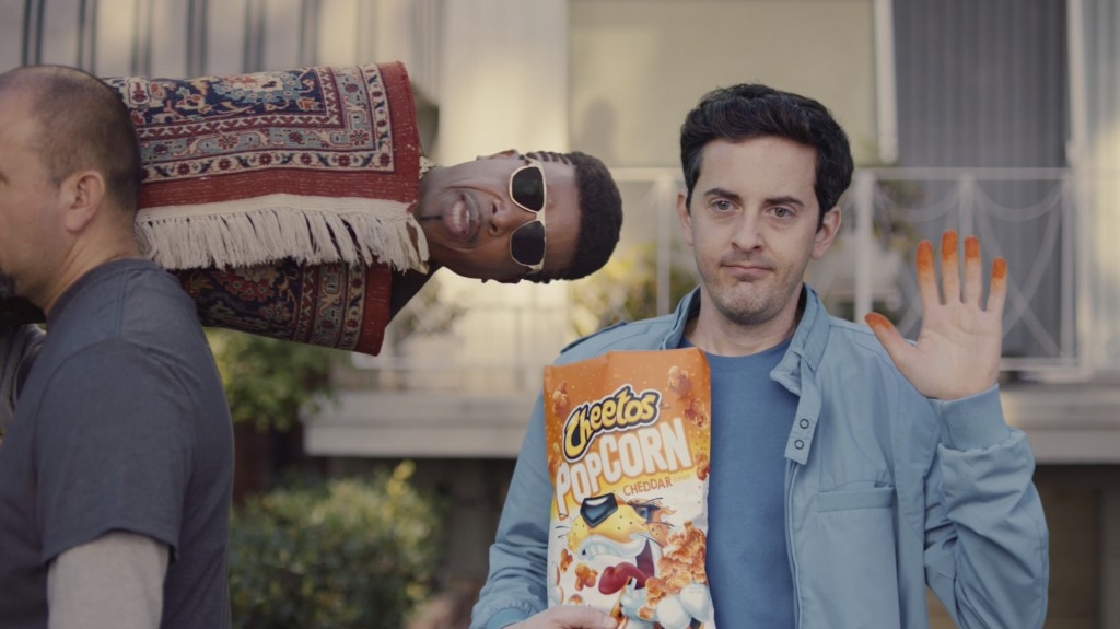 """This undated image provided by Cheetos shows MC Hammer in a scene from the company's 2020 Super Bowl NFL football spot. """"U Can't Touch This"""" is 30 yea..."""