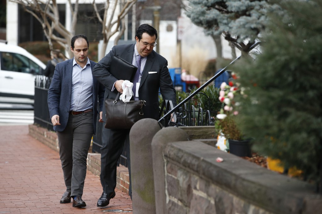 In this Jan. 28, 2020 photo, Jordan Sekulow, right, the executive director of American Center for Law and Justice, opens a gate as he arrives at a pro...