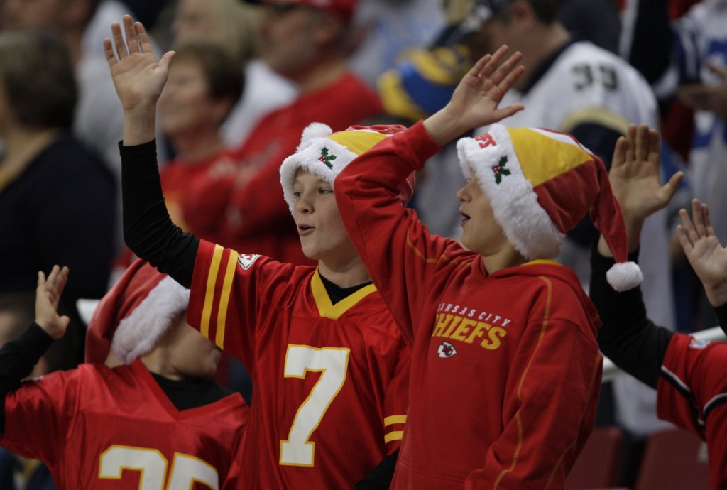 FILE - In this Dec. 19, 2010, file photo, Kansas City Chiefs fans celebrate with the tomahawk chop during the fourth quarter of an NFL football game a...