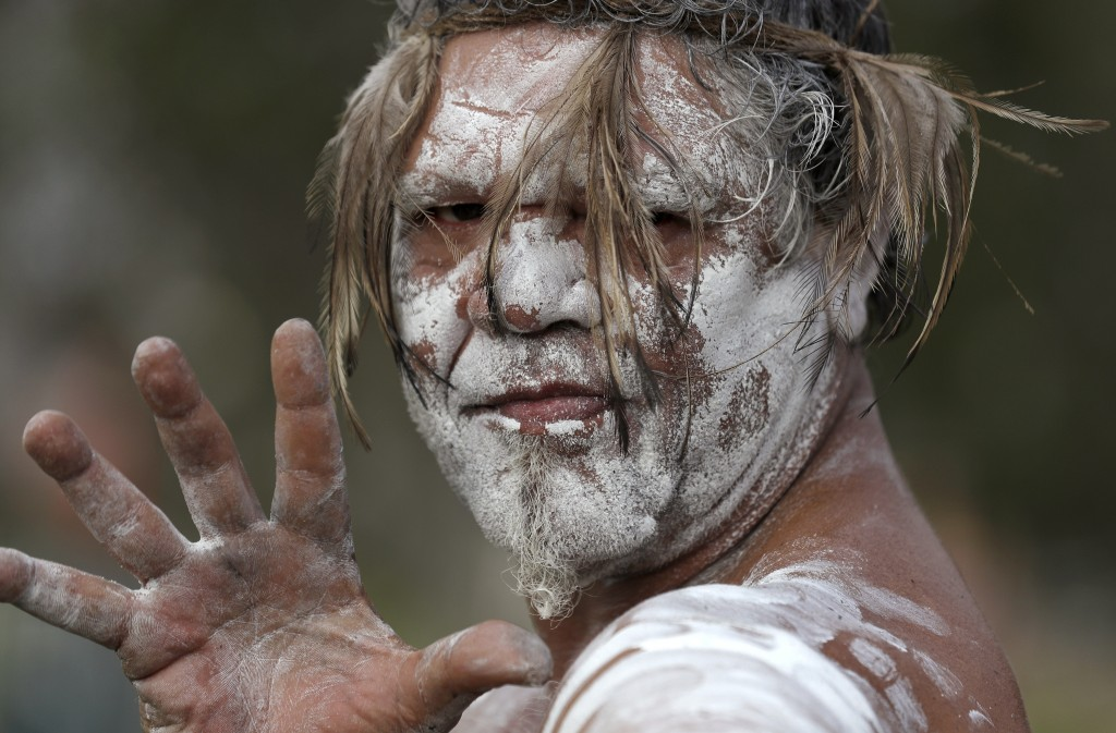 In this Sunday, Jan. 26, 2020, file photo, an Aboriginal man Anthony Kemp poses during the Wugulora Indigenous Morning Ceremony as part of Australia D...