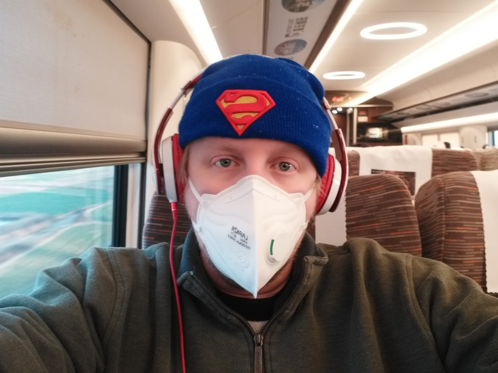 In this Friday, Jan. 31, 2020, photo, American citizen James Dickey sits on a train on his way back to his home in Changsha, China. Dickey, a kinderga...