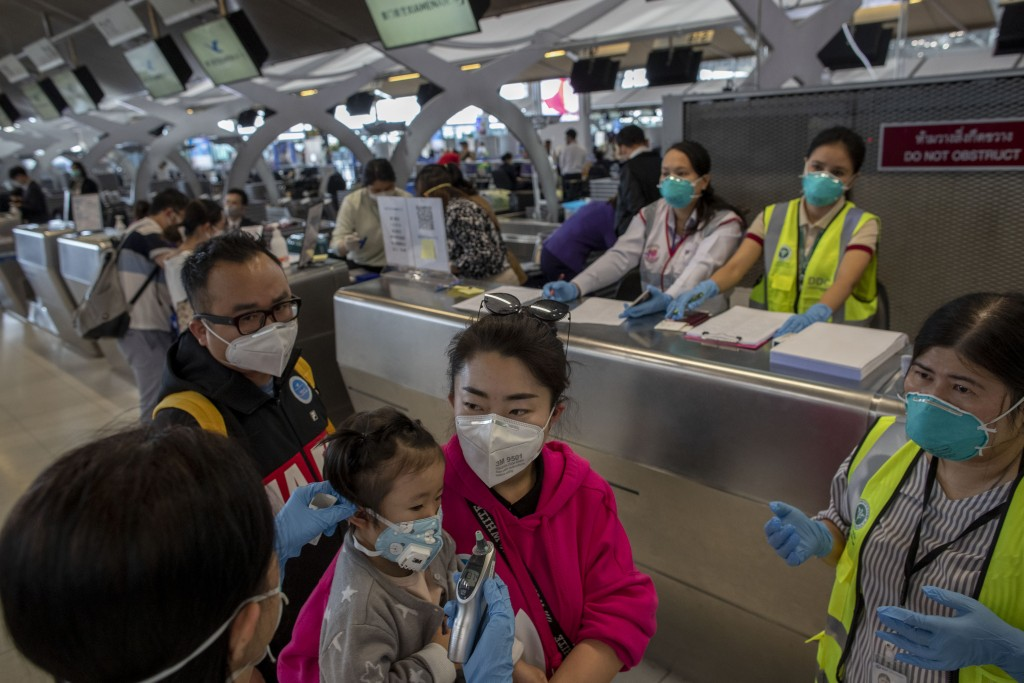 China flies citizens home to virus-hit Wuhan""