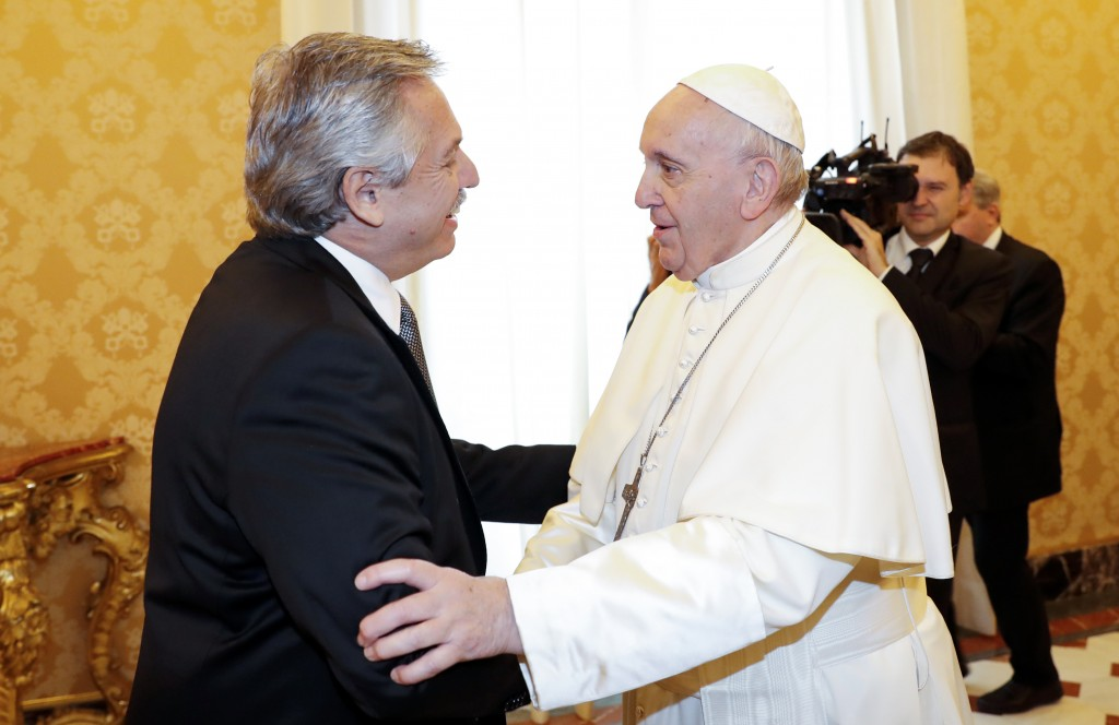 Pope Francis welcomes Argentina's President Alberto Fernandez, left, on the occasion of their private audience at the Vatican, Friday, Jan. 31, 2020. ...