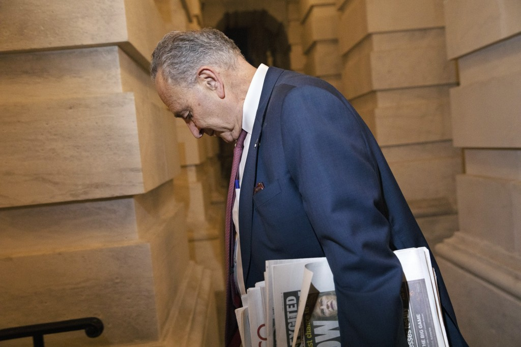 Senate Minority Leader Sen. Chuck Schumer of N.Y., leaves Capitol Hill in Washington, Friday, Jan. 31, 2020. The Senate narrowly rejected Democratic d...