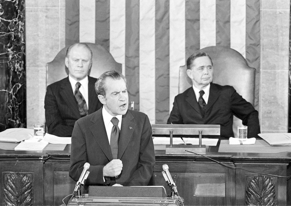 FILE - In this Jan. 30, 1974, file photo Vice President Gerald Ford and House Speaker Carl Albert listen to President Richard Nixon deliver his State ...