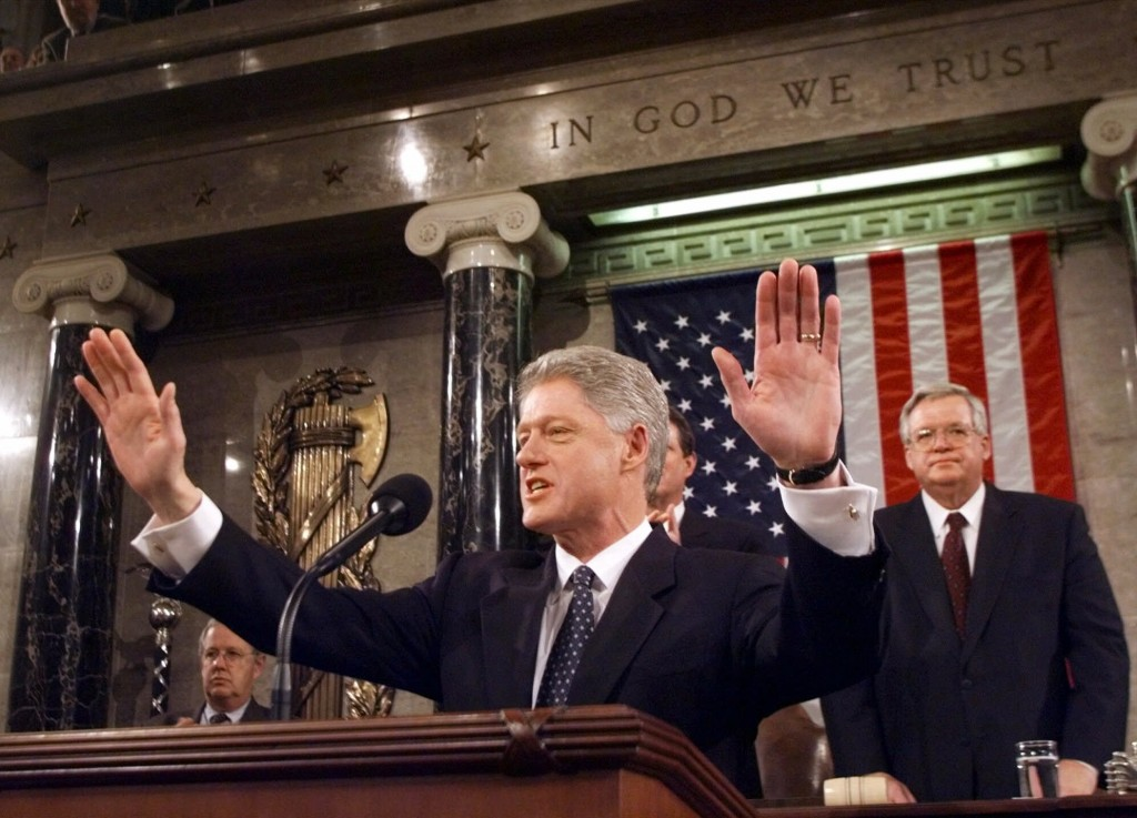 FILE - In this Jan. 19, 1999 file photo, President Clinton acknowledges the crowd prior to giving his State of the Union address on Capitol Hill . Hou...