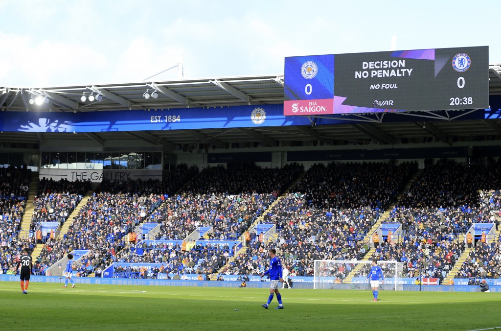 The big screen displays the VAR decision not to award a penalty during the English Premier League soccer match between Leicester City and Chelsea at t...